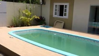 House with pool in Bombinhas-sc Junipers